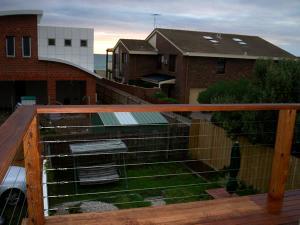 Balcony-with-merbau-stainless-steel-wire-railing