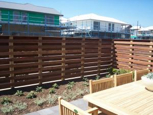 Fence with alternating merbau style