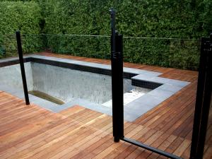 Glass pool fence with timber decking