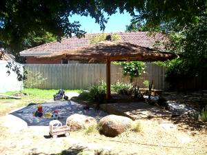 Kindergarden thatched pergola