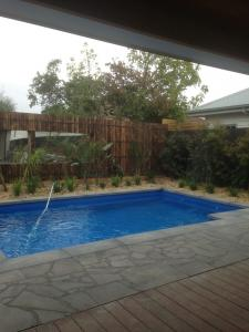 Pool fence with mirror