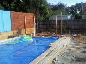 Pool house with glass pool fencing under construction