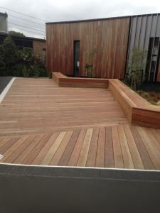 Timber deck with seats and garden wall
