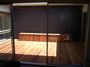 Timber decking with matching storage seat