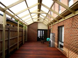 Timber gable roof pergola with transparent roof