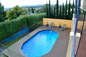 Timber verandah deck around pool