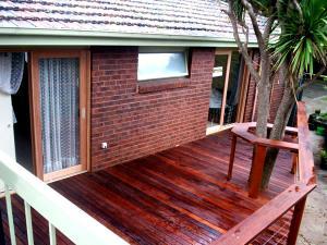 Verandah railing built around tree